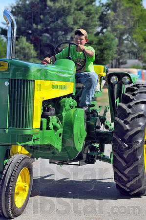 Tribune-Star/Jim Avelis<br /> Green machine: Jared Harlan drives a vintage John Deere tractor in the 4-H parade.