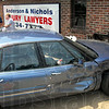 Insult to injury?: Terre Haute fire department personnel assist a driver involved in an accident at US 41 and Ohio Street Thursday afternoon. The building is the home of Anderson & Nichols injury attorneys. Ouch!