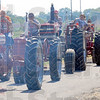 Tribune-Star/Jim Avelis<br /> Chuggin' along: Some tractors drew light duty in the 4-H parade Thursday, with no wagon to pull along behind.