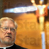 Strategic plan: Father Rick Ginther, Dean of the Terre Haute  Deanery speaks during Thursday's news conference.