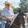 Tribune-Star/Jim Avelis<br /> Lead rider: Amy Gibson of the Sheriff's Posse led the horse and pony contingent in the 4-h Parade Thursday afternoon.