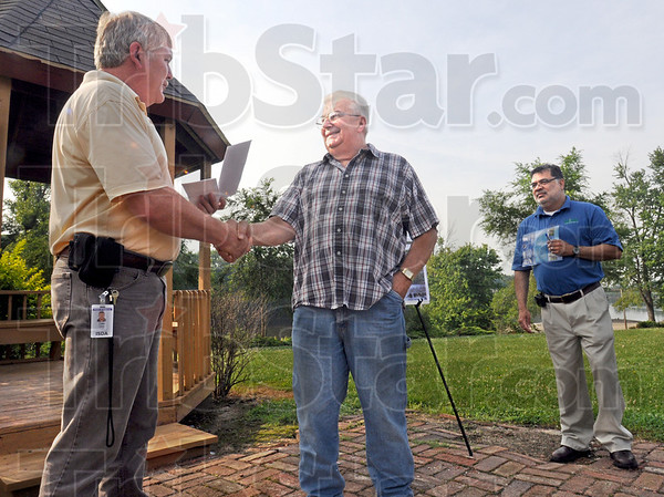 Payday: Dale Walker (L) presents a check for $41,000 to Kennethy Farrington Thursday morning. At right is Jon Mangles.