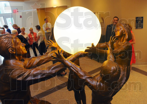 "Tribune-Star/Jim Avelis<br /> Hope for all: The sculpture by Kentucky artist Meg White was unveiled Thursday evening in the lobby of the Hux Cancer Center. ""The Light of Hope and Healing"" is the title of the work."