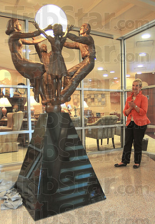 "Tribune-Star/Jim Avelis<br /> Newest addition: Cindy Cox, Chair of the board of Directors of Art Spaces looks over ""The Light of Hope and Healing"" she and Pat Martin just unveiled in the lobby of the Hux cancer Center."