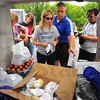 Tribune-Star/Jim Avelis<br /> Well supplied: Indiana State University staff members Heather Miklozek and Al Perone sort through supplies needed for the volunteers making the trip to Joplin for relief efforts.