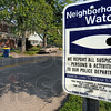 Watch area: A sign at 7th Street and Maple Avenue announces the Neighborhood Watch program in place in the Collett Park area.