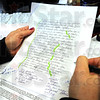 Analysis: Theresa Ortega does an analysis on handwriting by an incarcerated criminal offender in her office Thursday afternoon.