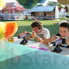 Tribune-Star/Rachel Keyes<br /> Fun and games: Jeremy King (left) and friend Josh Gayso (right) play a game on the midway at the Vigo County Fair.