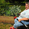 Tribune-Star/Jim Avelis<br /> Easy access: Linda Good can do her own weeding and harvesting at the Maryvale Apartments raised bed gardens.
