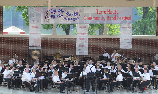 "Tribune-Star/Rachel Keyes<br /> Warm-up: The Greater Greenwood Community Band readies to start their performance at the ""On the Banks of the Wabash"" Community Band Festival they were joined by six other community bands from around the area."
