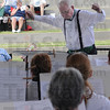 """Tribune-Star/Rachel Keyes<br /> Making music: Greater Greenwood Community Band Director Thomas Dirks conducts Shenandoah as part of his bands performance in """"On the Banks of the Wabash Community Band Festival."""