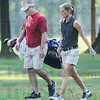 Tribune-Star/Rachel Keyes<br /> Walking it out: Cara Stuckey takes a walk with her catty down her fairway to set up for her next shot.
