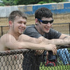Tribune-Star/Rachel Keyes<br /> Taking it in: Jeremy Thompson (left) and Ian Bolger watch as the crew at the Terre Haute Action Track try and clear the track for racing after Saturday nights storm.