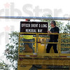 Installation: Terre Haute Street Department employees Ray Hollingsworth and Paul Stone install the Officer Brent D. Long Memorial Way sign Friday afternoon at Wabash and Brown Avenues.