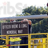 Memorial Way: Terre Haute street department employees Ray Hollingsworth and Paul Stone install a sign on the light fixture at Brown Ave and Wabash Avenue. The Sign Center produced the sign over-night so it could be installed today.