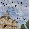 Tribune-Star/Jim Avelis<br /> Released: The Friday evening candlelight vigil for Brent Long began with a release of balloons.