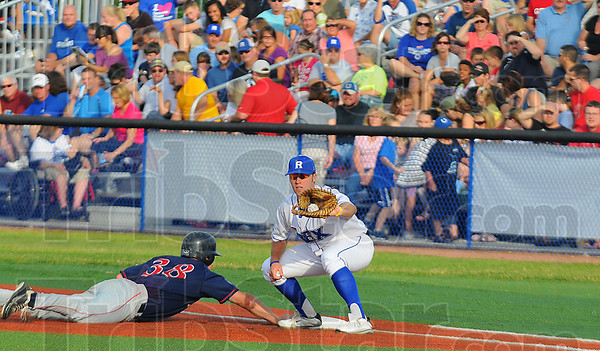 Tribune-Star/Jim Avelis<br /> Good crowd: Fans showed up Friday evening to watch the Rex take on the Chillicothe Paints at Bob Warn Field. Here John Loeffler waits for a Christian Slaznik pickoff throw that was too late to get paint baserunner Mitchell Broughton.