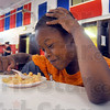 Tribune-Star/Jim Avelis<br /> Piece of cake: Nasir Gordon finishes up dessert after lunch at the 14th & Chestnut Community Center Thursday afternoon.