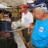 Tribune-Star/Jim Avelis<br /> Service project: Bill Allen and Jim Harvey team up to get brats ready for the evening rush at the Boy Scouts' fundraiser Friday eveing at Meadows Center.