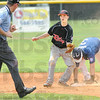 Showing the ball: Riley's #10, Sam Gehman shows the ball to the umpire in hopes of getting a sympathetic call during game action Friday. Saginaw's #3 Tyler Minnick beats the tag.