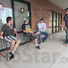 Tribune-Star/Jim Avelis<br /> Learning curve: Workers at the Wabash Valley Internationa House of Prayer talk outside the southside location Friday afternoon. Kevin Kolcheck and Kenny Brumback are interns there, along with Dustin Weddle, far right, while Matt Low, in light shirt is an employee.