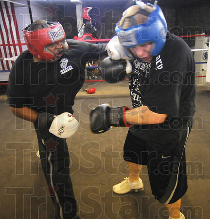 Tribune-Star/Jim Avelis<br /> Practice: James Porter spars with Chris Jeewett in Porter's basement ring in The Sweat Box Gym