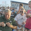 Tribune-Star/Rachel Keyes<br /> Biggest fan: Tommy John (left) takes time to sign an autograph for Dave Pitts (middle)  and stepdaughter Sarah Lonneman (right) at the Rex game Saturday.