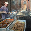 Chef: Greg Gauer and Pat Boatman prepare meats for the St. Ben's Festival Friday evening.