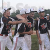 Tribune-Star/Rachel Keyes<br /> We win: Terre Haute North Little League team celebrates after winning the District Championship Saturday.