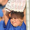 Tribune-Star/Rachel Keyes<br /> Waiting for foul: 7-year-old Karlie Thomas waits to catch a foul ball at the Rex game Saturday.