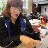 Analysis: Certified handwriting expert Theresa Ortega does an analysis on a signature in her office Thursday afternoon.