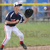 Tribune-Star/Rachel Keyes<br /> See it catch it: Terre Haute North's Grant Kriby makes a stop in the infield in action Saturday.