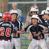 Tribune-Star/Rachel Keyes<br /> Homerun: Teammates congratulate Bailey Barnes after hitting a homerun  in action Saturday.