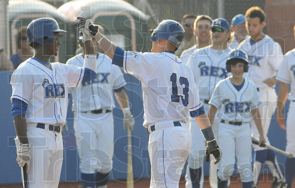 Tribune-Star/Rachel Keyes<br /> Happy Birthday: Birthday boy Lucas Hileman is congratulated by teammates after hitting a homerun at his first at bat in action Saturday.