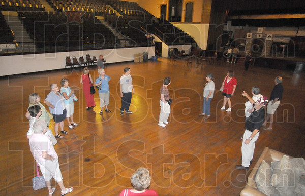 Tribune-Star/Rachel Keyes<br /> Seeing inside: People take a tour of the Zorah Shriner's Building they stop in the upstairs auditorium were the Shriner's once held the Zorah Circus.