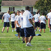 Tribune-Star/Jim Avelis<br /> Happy campers: Stewart Williams works with linemen Saturday morning at Camp Weatherford.