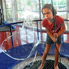 Bubble blower: Nine-year-old Rachel Chubb stands inside a bubble and blows during her visit to the Terre Haute Children's Museum.