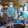 Amazed: The Linn brothers, Aiden (2) and Gavyn (3) visit the Terre Haute Children's Museum during a stay with their grandmother, Mary Ellen Linn. The children are visiting from Indianapolis.