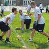 Tribune-Star/Jim Avelis<br /> Oversight: Kyle Kleckner, a teammate of Steve Weatherford's at Illinois, directs campers Laine Trimble and Ryan Moshack in blocking drills.