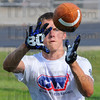 Tribune-Star/Jim Avelis<br /> Drilling: Terre Haute North student Cole Seward hauls in a pass during reciever drills Saturday at Camp Wetherford.