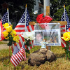 Tribune-Star/Jim Avelis<br /> Neighbors: A small memorial has been placed at the corner of North 8th and Ash streets to remember the sacrifice of Terre Haute police officer Brent Long.