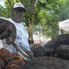 Tribune-Star/Rachel Keyes<br /> Cooking up some BBQ: Raymond Thompson owner of Lil Pigs cooks up his famous BBQ for the Brickyard BBQ Fest Saturday morning.