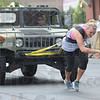 Tribune-Star/Rachel Keyes<br /> Strong woman: Molly Martin pulls an truck as part of the Strong Man competition Saturday.