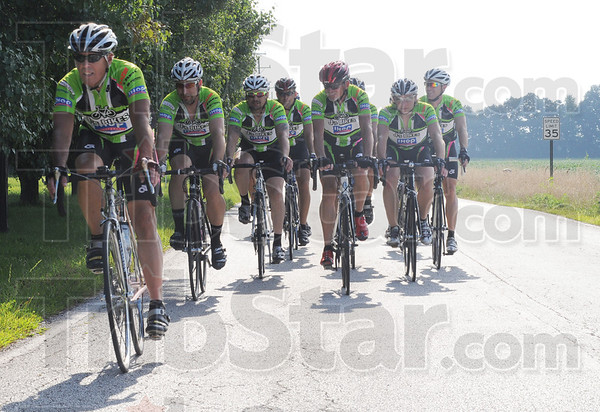 Tribune-Star/Rachel Keyes<br /> Riding pack: The J's Bike Club makes their first turn on a 26-mile practice route.