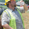 Tribune-Star/Rachel Keyes<br /> Liquid cool: Terre Haute Waste Management worker Chad Sappingfield takes a long cool drink on a job site near Lafayette and Haythorne.