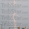 Tribune-Star/Jim Avelis<br /> Shocking sight: Lightning drops out of rain cloud Friday evening. Seen from the Vigo County courthouse parking lot, the rains brought an electrical storm with them, knocking out power and setting off security alarms around the area.