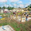 Tribune-Star/Rachel Keyes<br /> Busy bees: A group of citizens from Rosedale gather at the Rosedale Park to raise a a new shelter thanks to funding by The Parke County Foundation and Duke Energy.