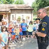 Tribune-Star/Rachel Keyes<br /> Day Camp: Sgt. Mike Ellerman talks with a group of kids participating in the Deming Park Day Camp.