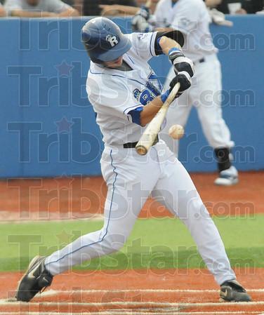 Tribune-Star/Rachel Keyes<br /> Bust it: The Rex's Christian Slaznik cracks a fast ball into center field Saturday evening.