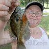 Catch of the day: Nine-year-old Jake Dennis proudly displays his catch from the entrance pond at Deming Park Saturday.